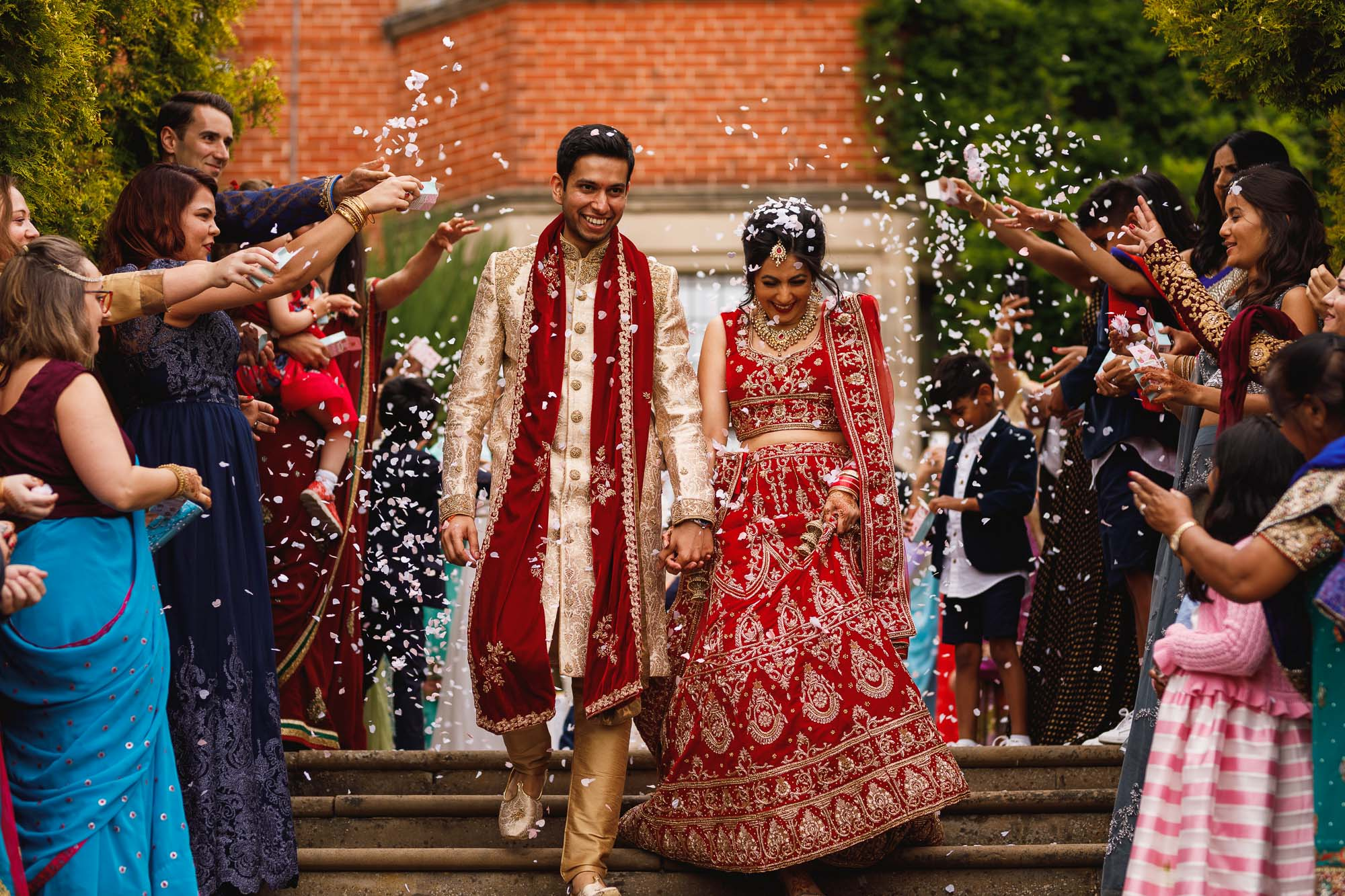Dunchurch Park Hotel, Midlands Asian Wedding Photographer, bride and groom confetti