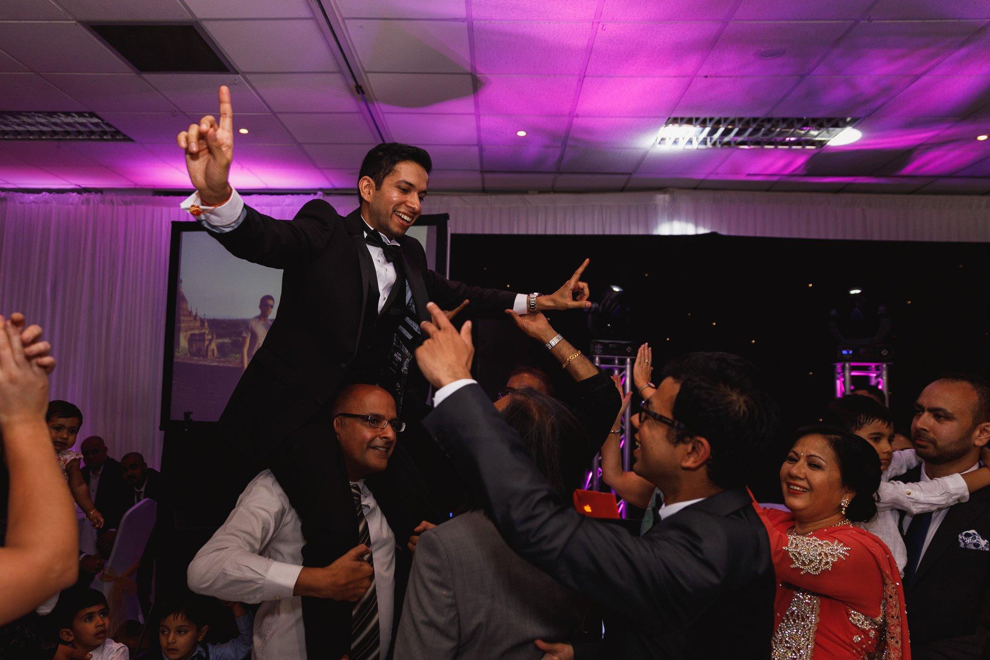 Dunchurch Park Hotel, Midlands Asian Wedding Photographer, groom on dancefloor