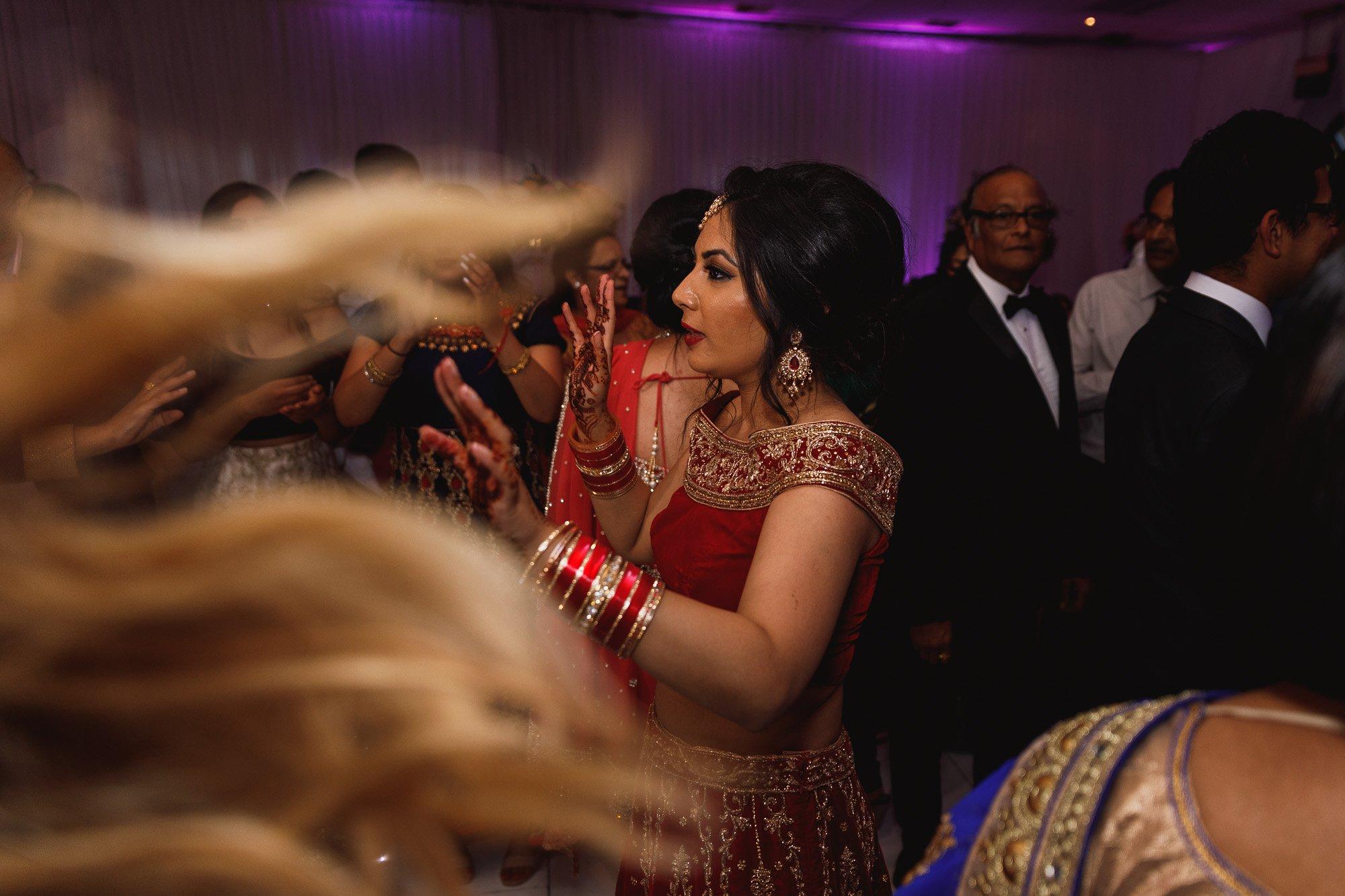 Dunchurch Park Hotel, Midlands Asian Wedding Photographer, bride on dancefloor