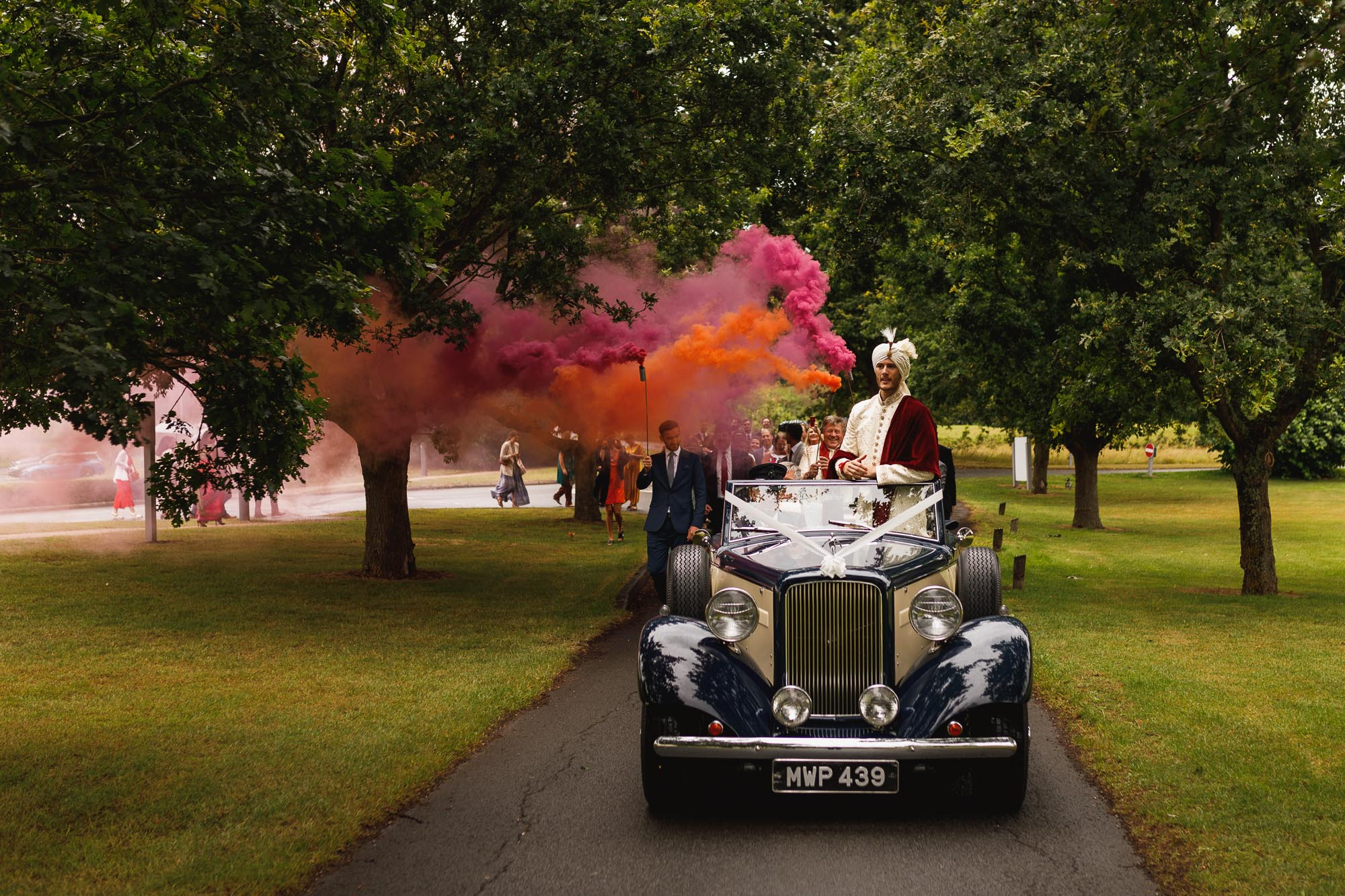 De Vere Wokefield Estate, Asian wedding photographer, grooms entrance, smoke bombs, smoke grenades