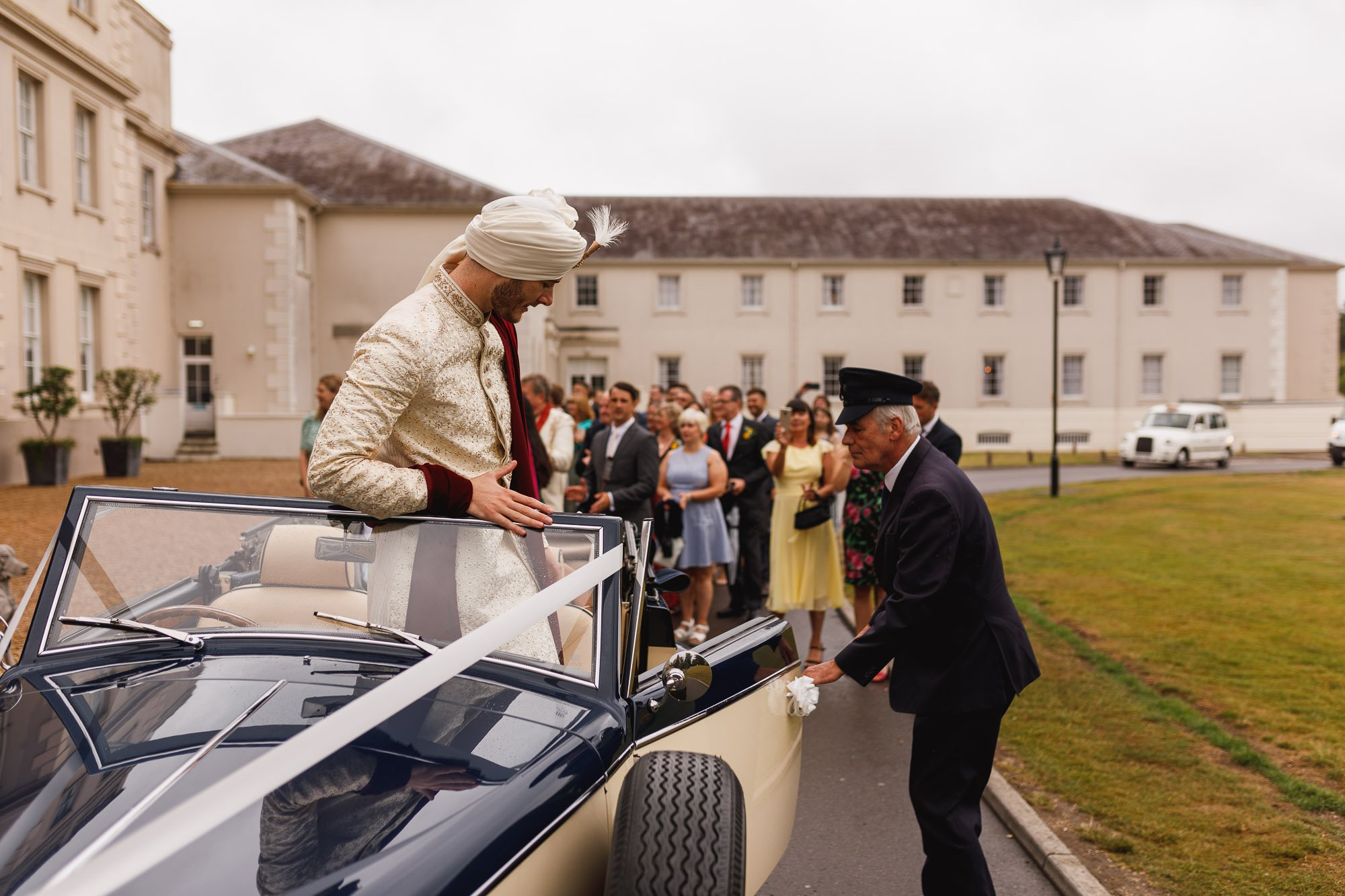 De Vere Wokefield Estate, Asian wedding photographer, grooms entrance, grooms arrival, vintage car