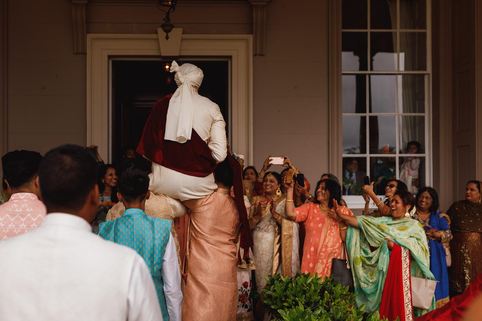 De Vere Wokefield Estate, Asian wedding photographer, grooms entrance, grooms arrival