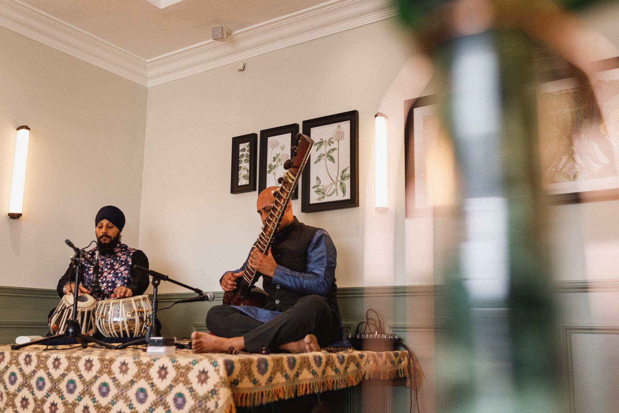 De Vere Wokefield Estate, Asian wedding photographer, live music, sitar