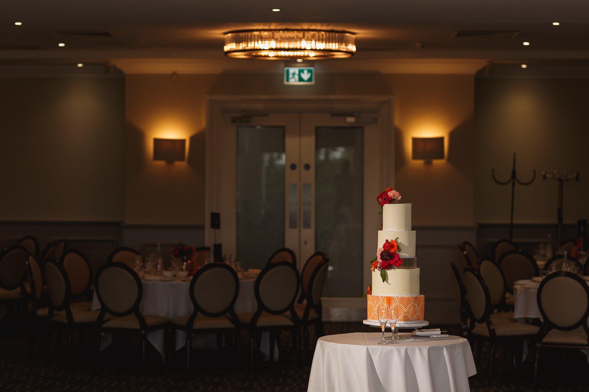 De Vere Wokefield Estate, Asian wedding photographer, reception, wedding cake, Paari Cakes