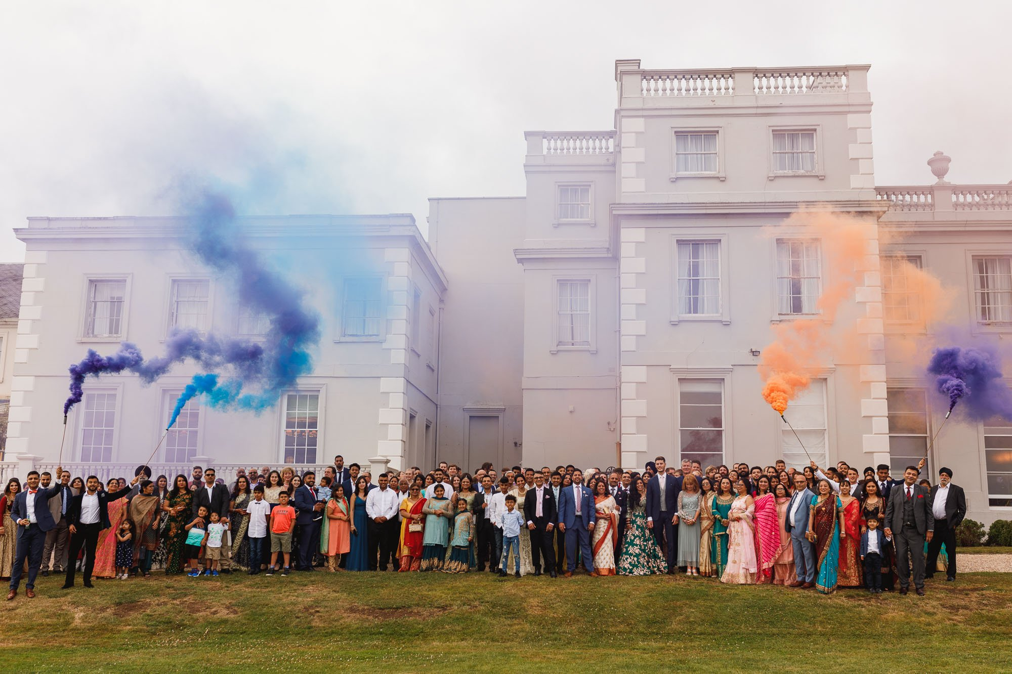 De Vere Wokefield Estate, Asian wedding photographer, reception, crowd portrait, smoke bomb, smoke grenades