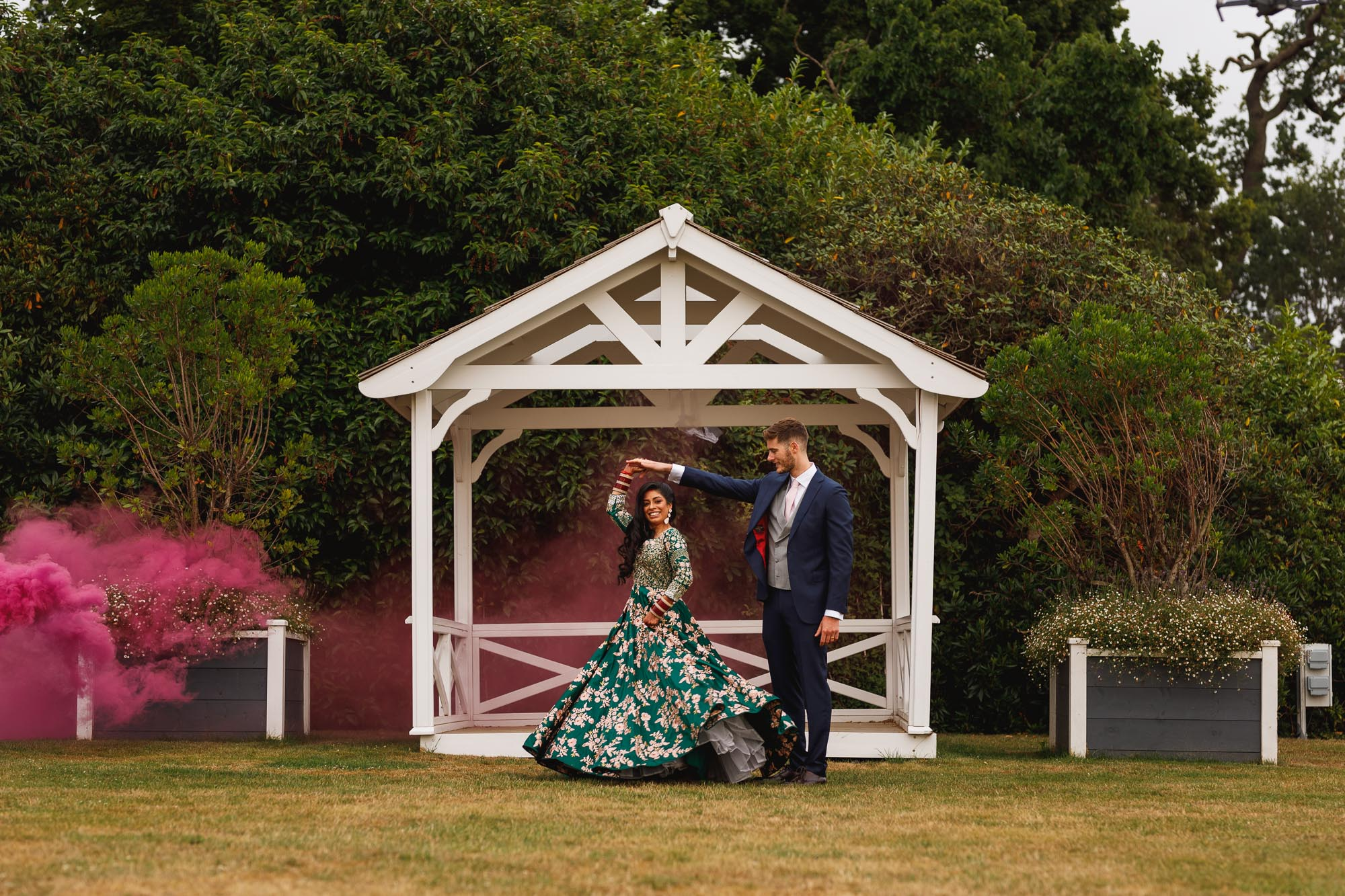 De Vere Wokefield Estate, Asian wedding photographer, reception, bride and groom portrait, smoke bomb, smoke grenades