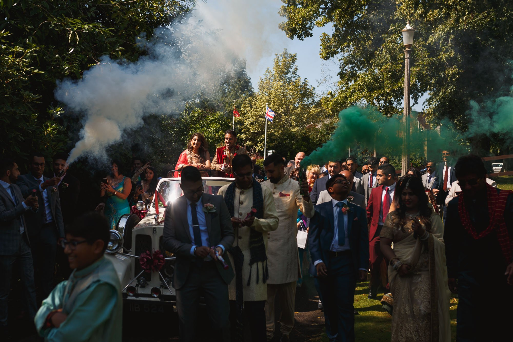 Dunchurch Park Hotel, Asian wedding photographer Midlands, jaan arrival, smoke grenades