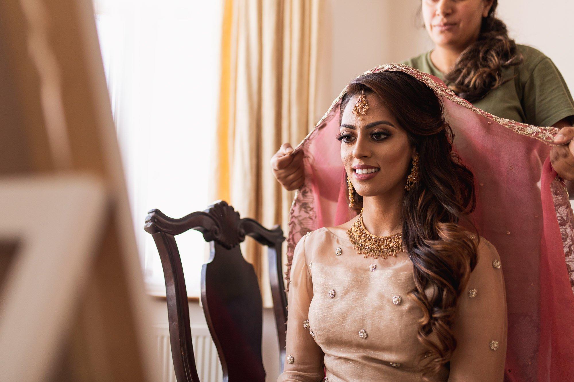 Epsom Racecourse, Surrey, Asian wedding photographer, bride getting ready