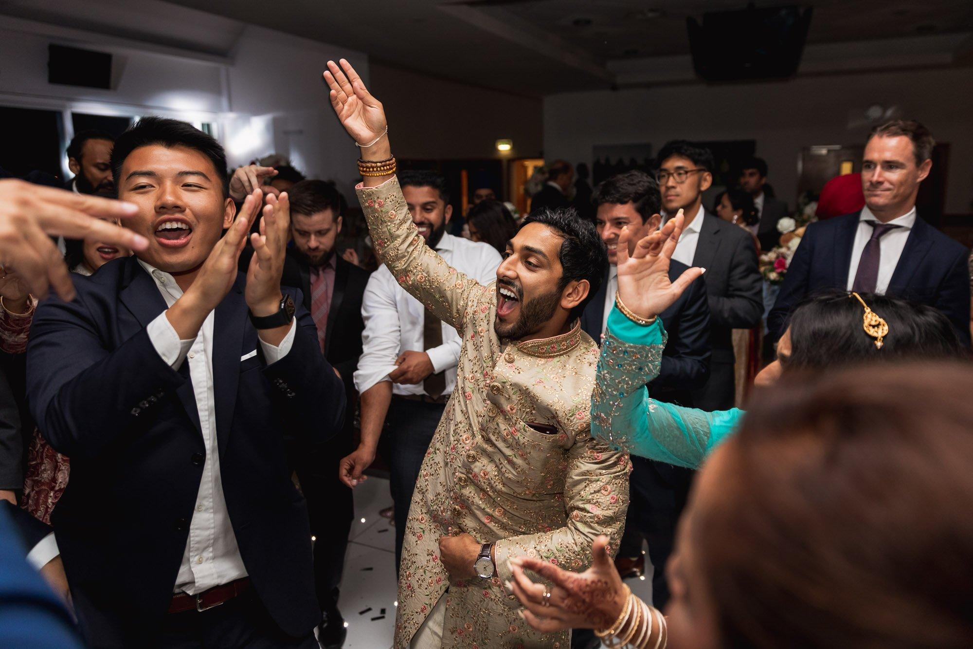 Epsom Racecourse, Surrey, Asian wedding photographer, dance floor