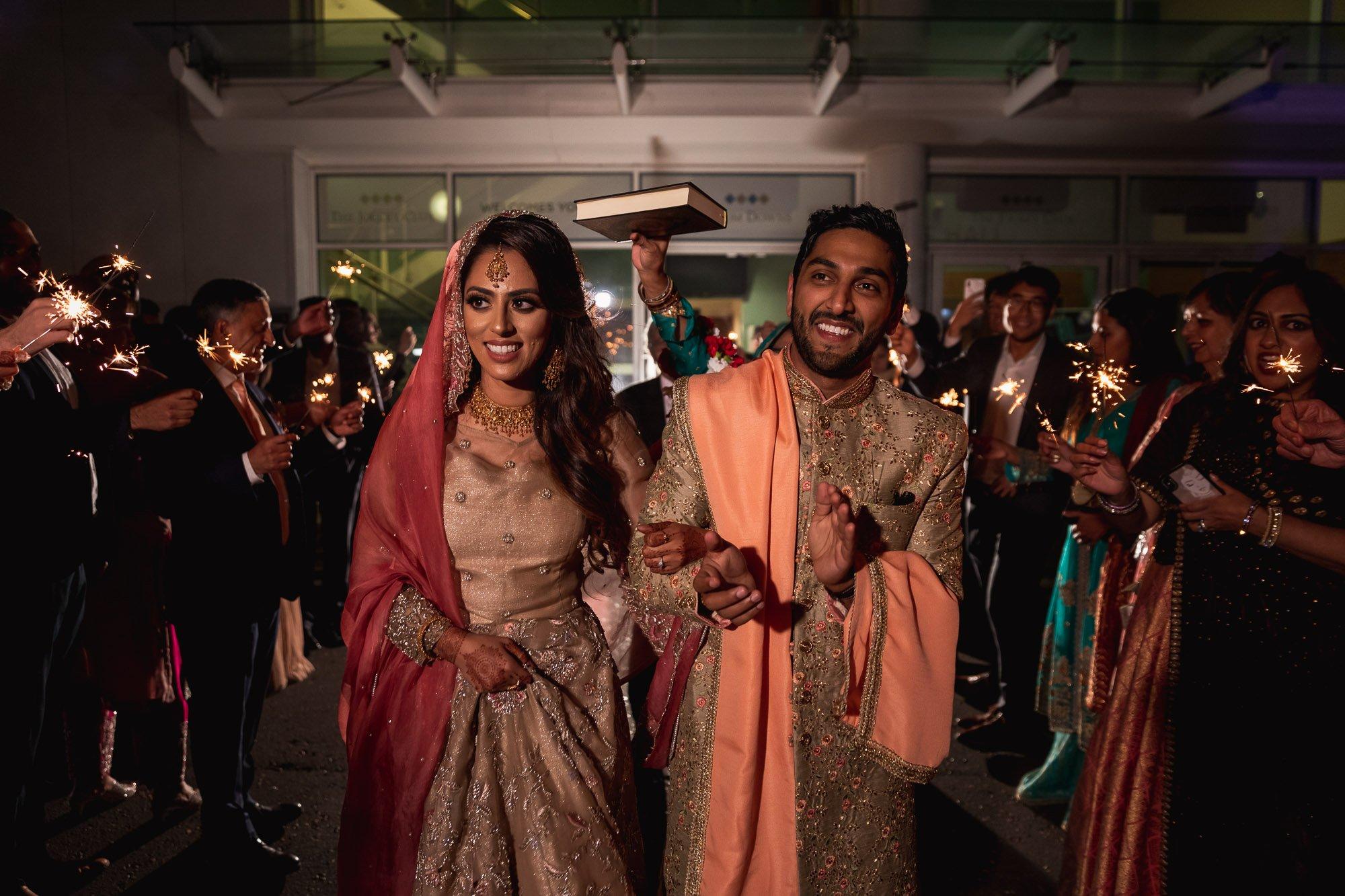 Epsom Racecourse, Surrey, Asian wedding photographer, sparkler exit