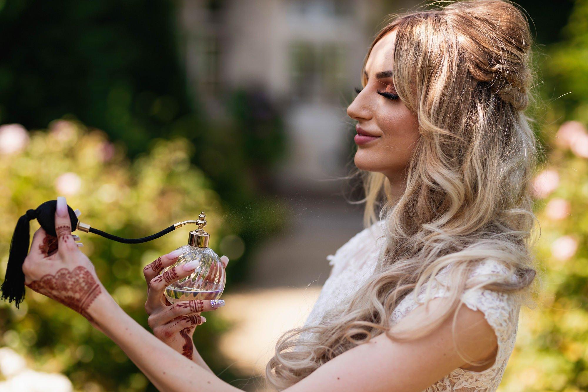 Euridge Manor, Cotswolds, English bride, dressing gown, perfume, Asian Wedding Photography
