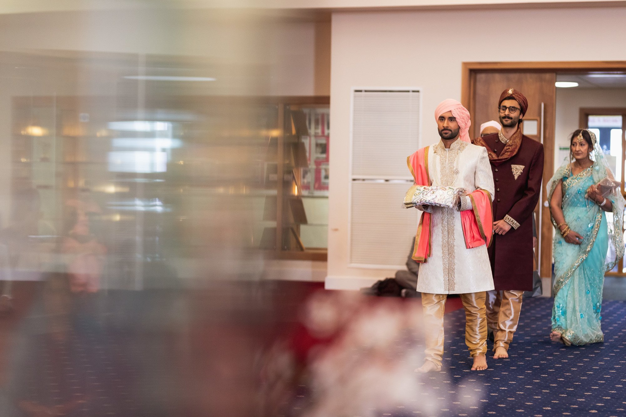 Guru Nanak Sikh Academy, grooms entrance, London, ceremony, Sikh wedding photographer