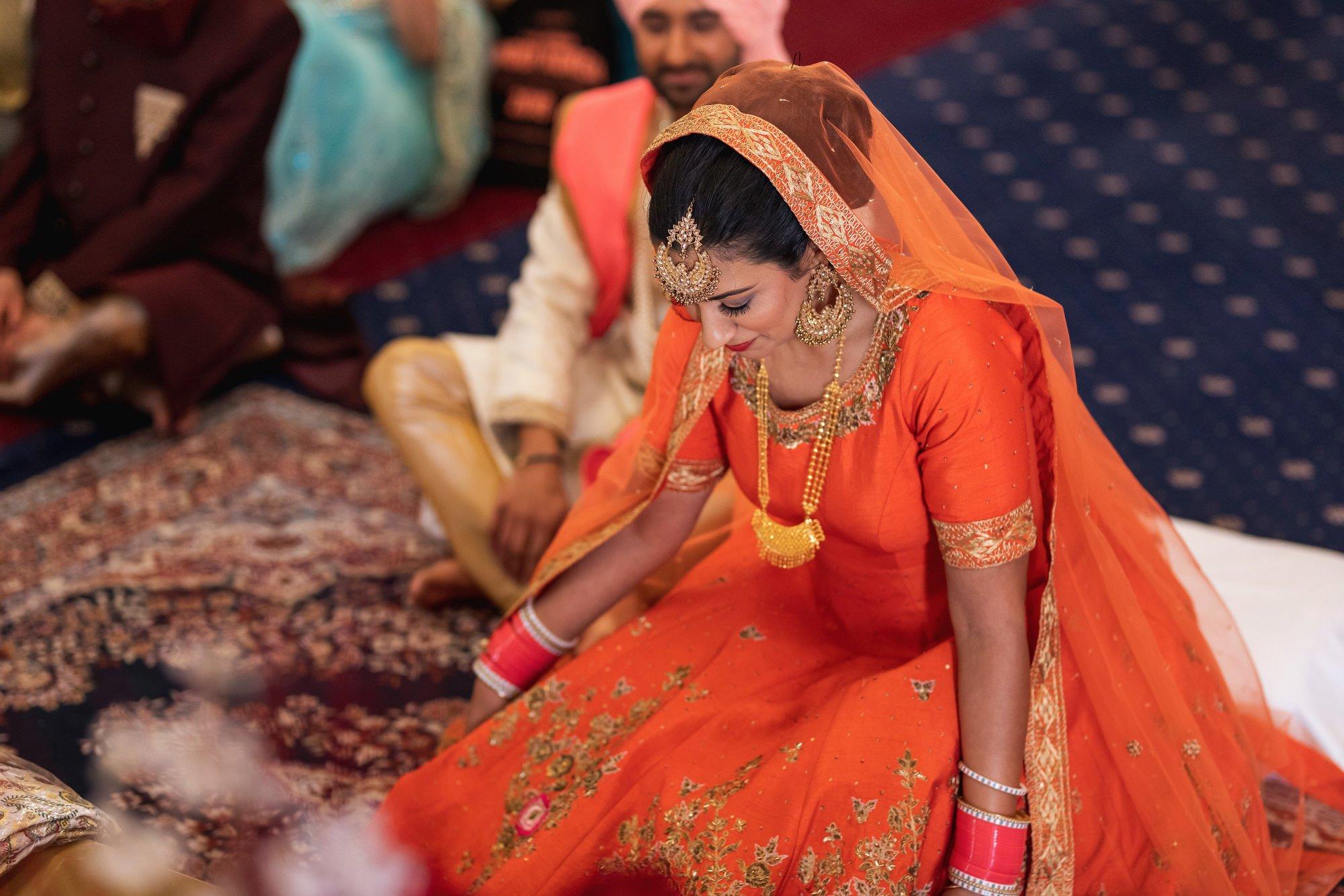Guru Nanak Sikh Academy, brides entrance, London, ceremony, Sikh wedding photographer